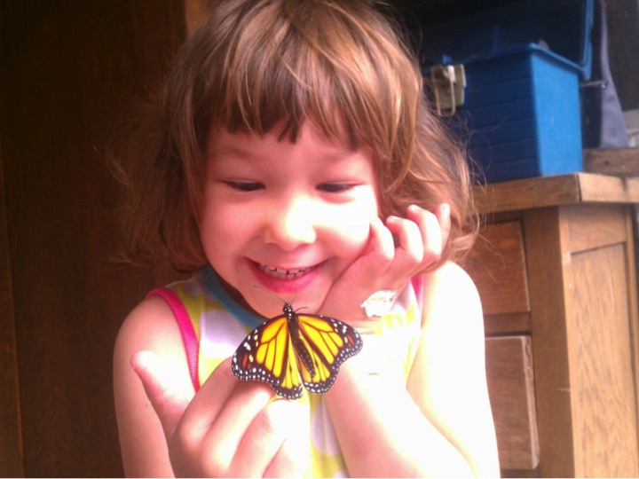 Nola Hamilton Garcia with Monarch butterfly