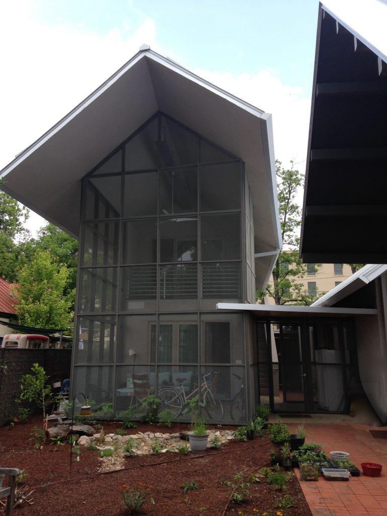 Backyard garden with screened porch